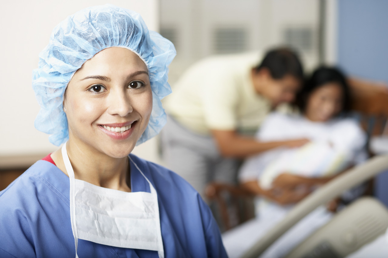 Smiling Physician near New Family