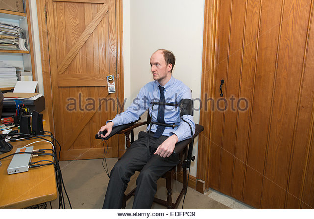 man-being-examined-using-a-polygraph-test-lie-detector-machine-which-edfpc9